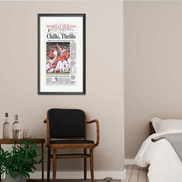 """Chills, Thrills"" Phillies World Series 2008 Reprint Framed with Mat, Hanging on Wall Behind an Elegant Set of Furniture"