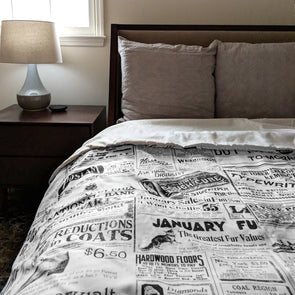 Vintage Inquirer Ad Collage Duvet Cover in Bedroom with Nightstand and Lamp beside bed with pillows