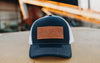 IT006 - Ind. Trad. Leather Patch Trucker Hat