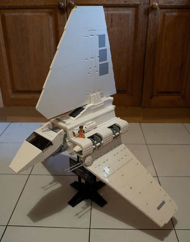 LEGO Minifigure Emmet, from The LEGO Movie, standing on the Imperial Shuttle.