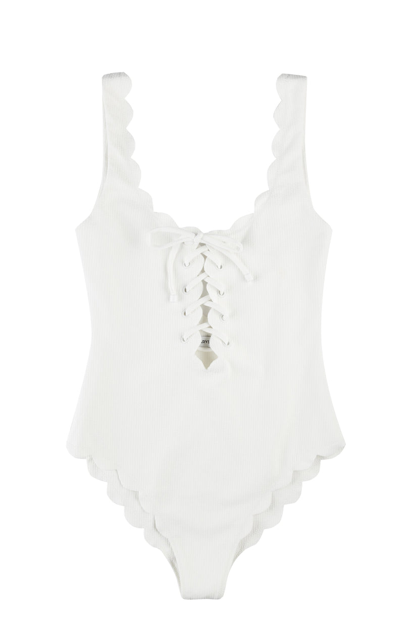A designer one piece, trimmed in scallops in a classic white color