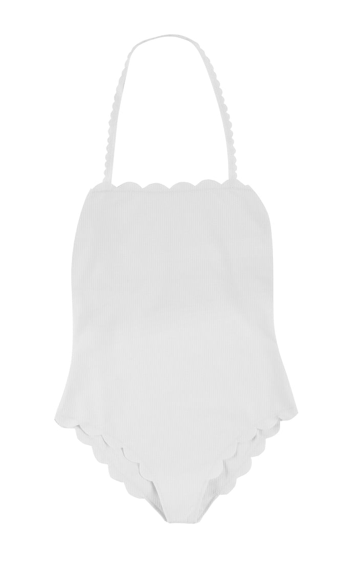 A white strapless one piece with a signature Marysia scallop trim and a back cutout