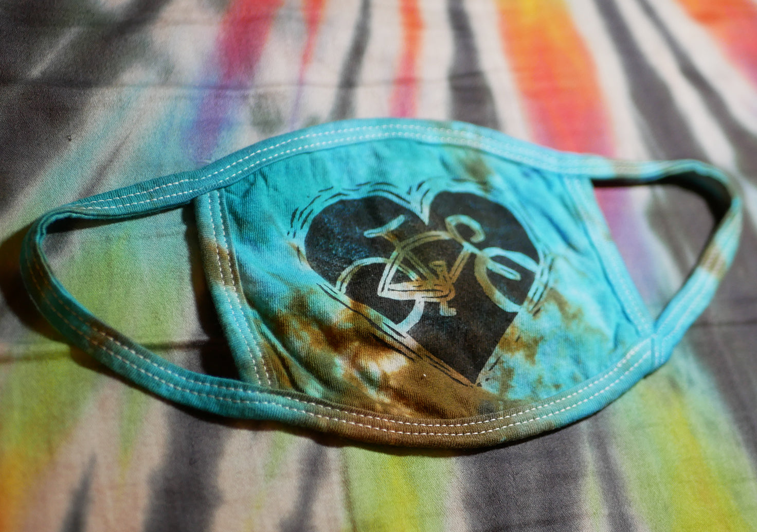 """BIKE LOVE MASK - LIGHT BLUE/BRONZE"" Hand-Stamped & Tie-Dyed Cotton Face Mask (Limited Quantity)"