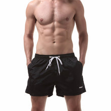 Ibiza Swim Shorts in Black on model
