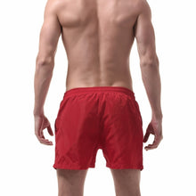 Ibiza Swim Shorts in Red on model