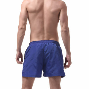 Ibiza Swim Shorts in Blue on model
