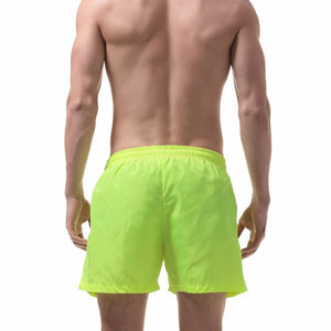 Ibiza Swim Shorts in Line Green on model