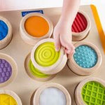 Tactile Search and Match.  Nine different textures on oversized puzzle piece match to a corresponding spot on the sturdy puzzle board. Practice classification and patterning skills with this engaging, tactile matching game.