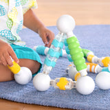 Grippies® Shake, Build and Curve - 70 pc. set.  ntroduce young builders to magnetic construction, sensory exploration and social-emotional expression.