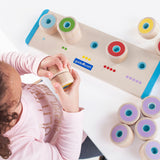 Count and Stack Poppers.  Encourage counting and matching skills as well as auditory stimulation with the popping stackers and corresponding receptacle board.