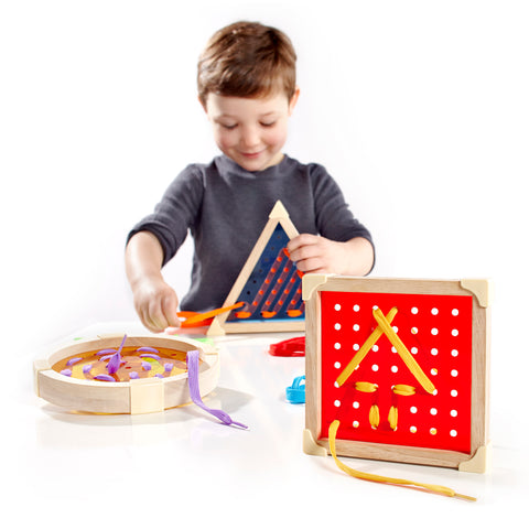 Geo Shape Lacing.  These manipulatives are easy for little hands to grasp and are for developing essential and cognitive skills including fine motor skills, hand-eye coordination, as well as visualization and process.