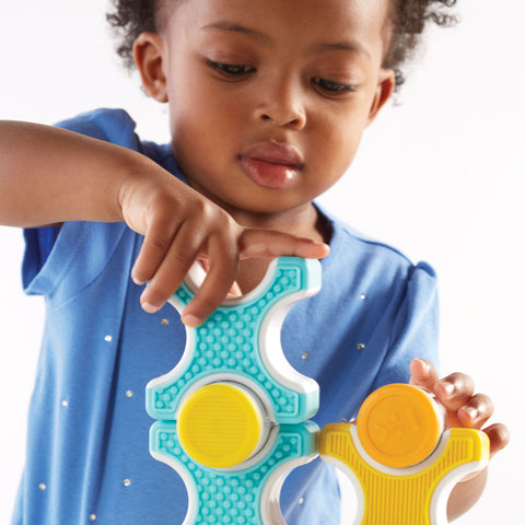 Grippies® Stackers - 16 Piece Set.  The stimulating blocks and cylinders encourage patterning, balancing, and matching skills with four bright colors and textures.