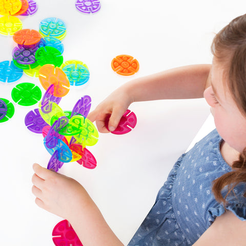 Interlox Discs set helps children discover symmetry and asymmetry while strengthening their design, structure and engineering skills