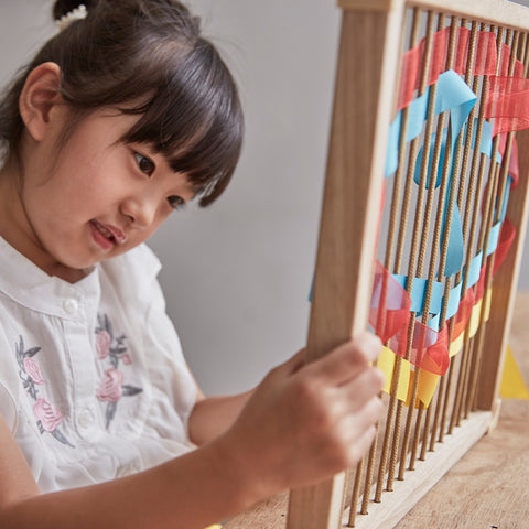 Jumbo Weaving Frames. Children can experiment with layering, patterns, emotional expression, and abstract pictures within the square, circular, and triangular frames.