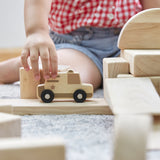 Mini Wooden Trucks - Set of 10. Give context to architecture and communities with hand-held, birch plywood trucks. Each features natural-toned, heat-transfer designs to associate seamlessly with traditional unit block play.