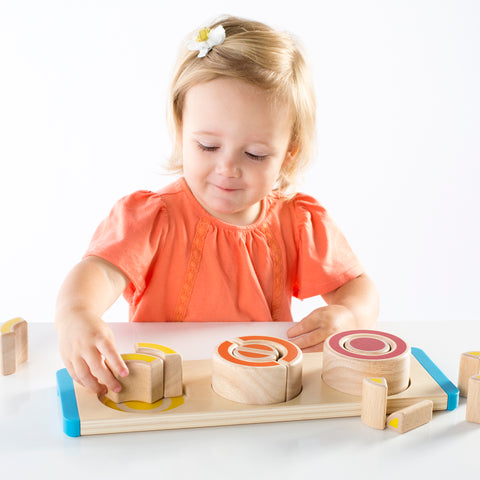 Nesting Circle Fractions. The sturdy puzzle board has overmolded handles for easy mobility. Promote physical understanding of mathematical concepts as well as negative space and differentiation using the tactile fraction pieces.