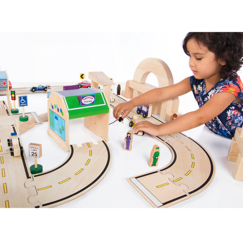 Community & Roadway Essentials.  Our 36 piece wooden block play set encompasses all the vehicles, signs and people necessary to complete this set.