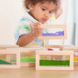 Sensory Rainbow Blocks - 18 pc. set.  An adventure in color, light, and sound! Encourage sensory exploration by combining blocks to form new colors and sounds, or stack the blocks in a different order each time to form new and exciting shapes.