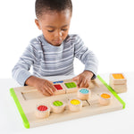 Tactile Matching Maze.  Chunky square puzzle pieces with textured centers can be rearranged to create new patterns for toddlers to follow with the Tactile Matching Maze toddlers can practice fine motor, problem-solving and matching skills.