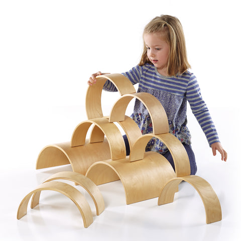 Arches and Tunnels.  Children incorporate block building arches and tunnels to create new and exciting structures.  Ages 3+.