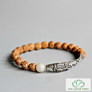 Himalayan Rudraksha With Buddhist Lotus Fish Charm Bracelet