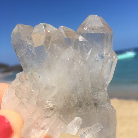 clear quartz cluster on the beach