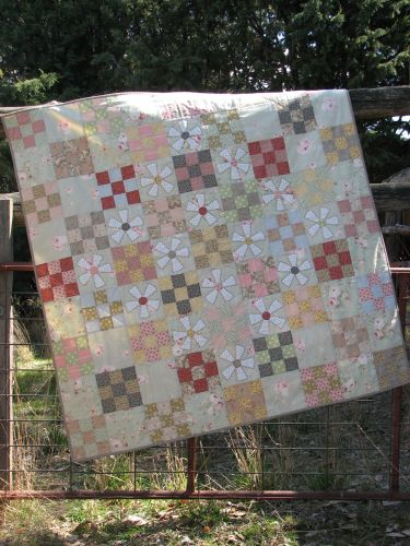 Hatched and Patched Mill Flower Quilt