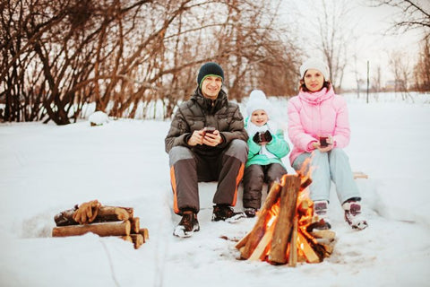 winter camping family of three
