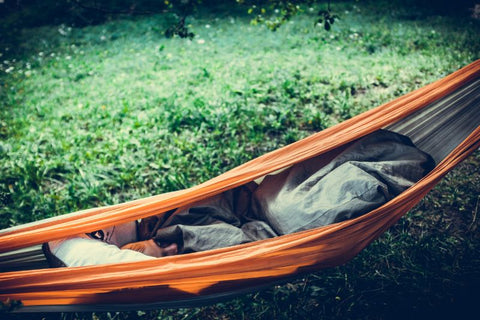 sleeping child on a hammock