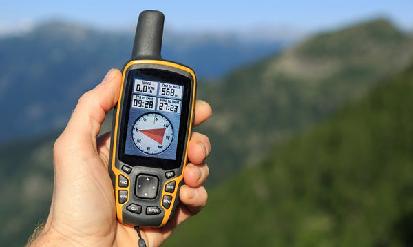 A person holding a GPS.