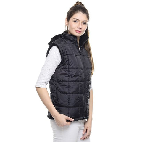 A lady wearing a PrimaLoft insulated vest