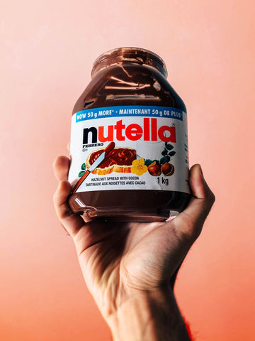 hand holding nutella