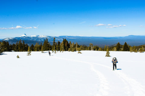 two people snow shoeing at crater lake