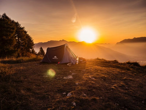 tent camp and sunset