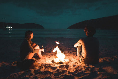 couple by camp fire