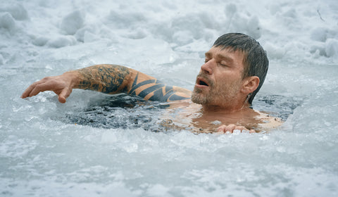 A man soaked in icy water during winter