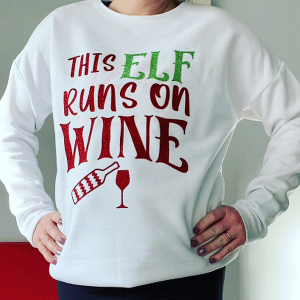 Christmas Jumper this elf runs on wine