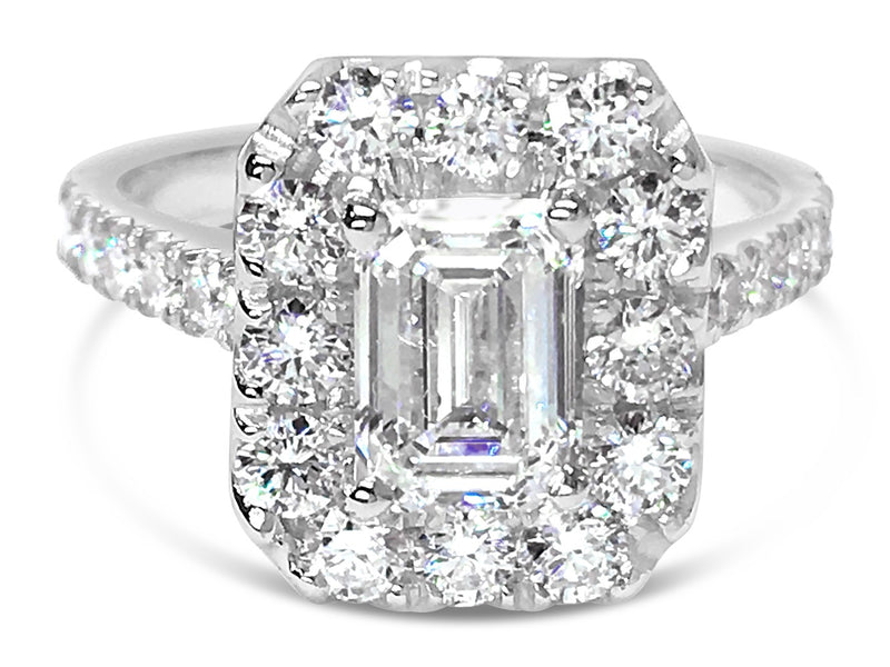 Emerald Cut Diamond With Large Diamond Set Halo