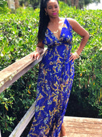 This beautiful blue floral print maxi dress with pleated bottom and side slits is perfect for your next getaway or brunch date