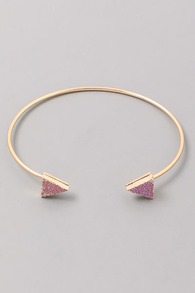 gold bangle with pink and purple stones