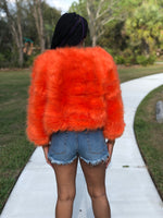 orange cropped waist length faux fur coat with 3/4 length sleeves