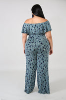 plus size navy blue tropical print wide leg jumpsuit with front waist tie and v wire front