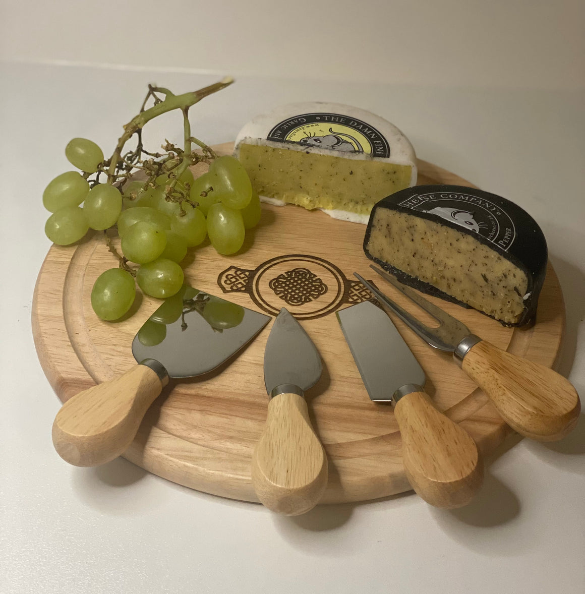 wooden cheese board with 4 cheese knives