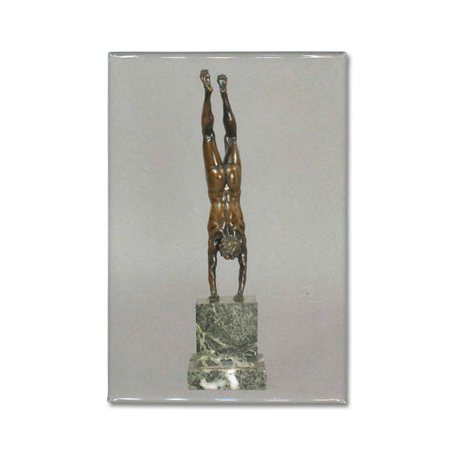 An Acrobat statuette reproduced on a souvenir magnet