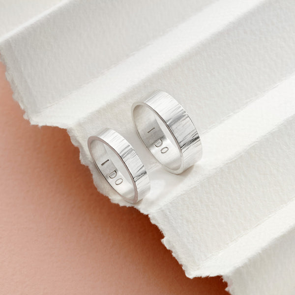 Silver personalised his and hers rings
