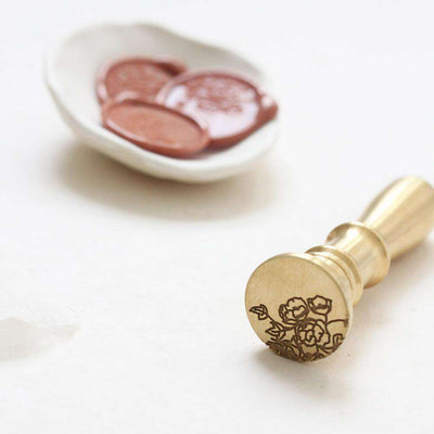 Genevieve Wax Stamp