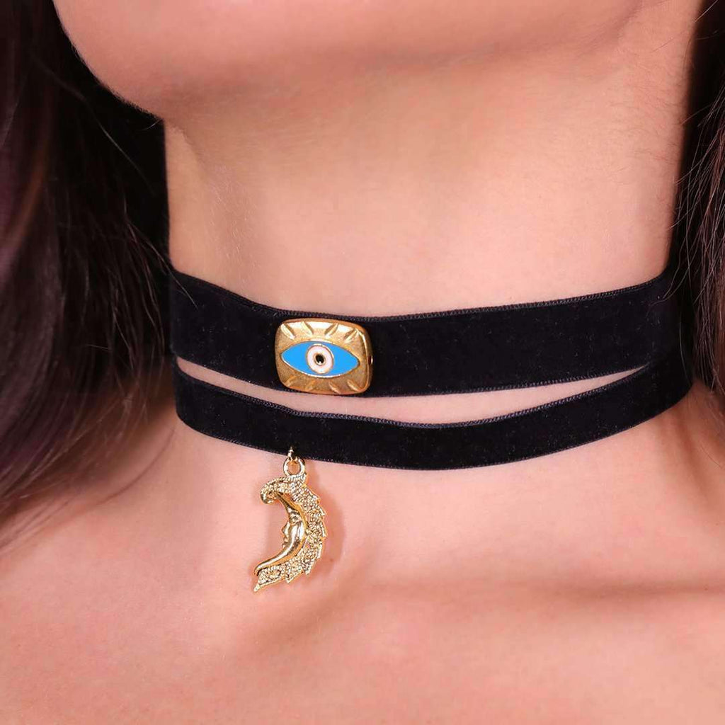 Black velvet choker with golden half moon