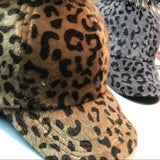 Cheetah print snapback with faux fur pom pom puff