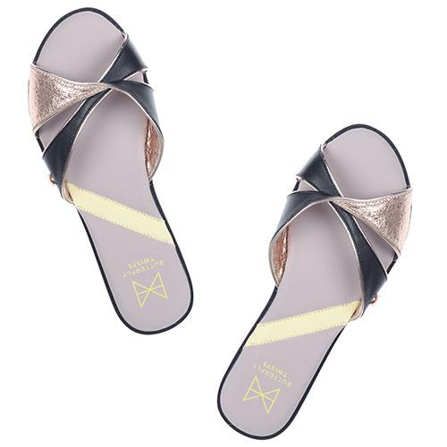 Introducing our new twist slide, ORA. Executed with a cool flash of black and shimmery rose gold this style has been created for that day-to-night transition, from beach to bar wear. An open toe slide Twist detailing combining faux black leather and metallic cracked rose gold Cushioning memory foam insoles for added comfort Twist Tech Technology Durable, skid resistant rubber sole We deliver to over 50 countries worldwide. to see which countries we deliver to please visit outåÊFAQåÊsection.