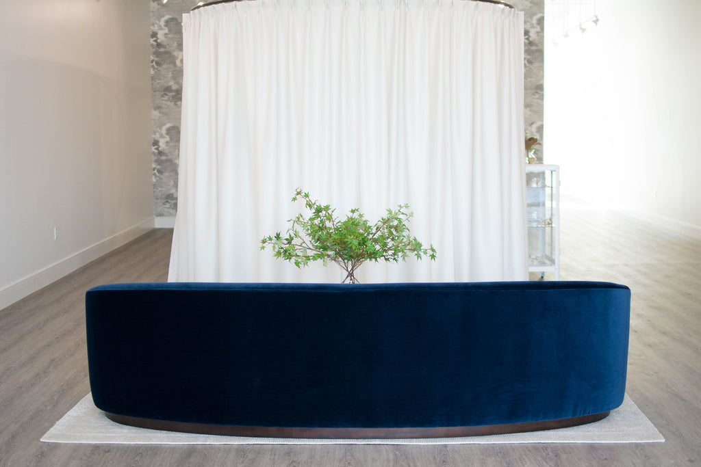 arc bridal boutique omaha nebraska wedding dresses nyc amethyst home indigo navy velvet curved sofa brass round coffee table